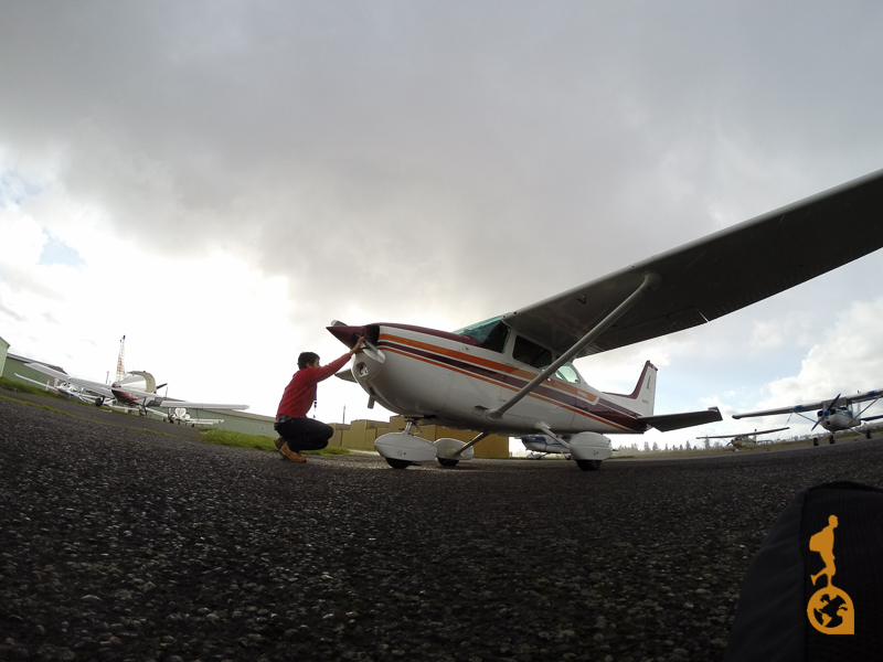 A pilot pre-checking an airplane cessna 172 before flying